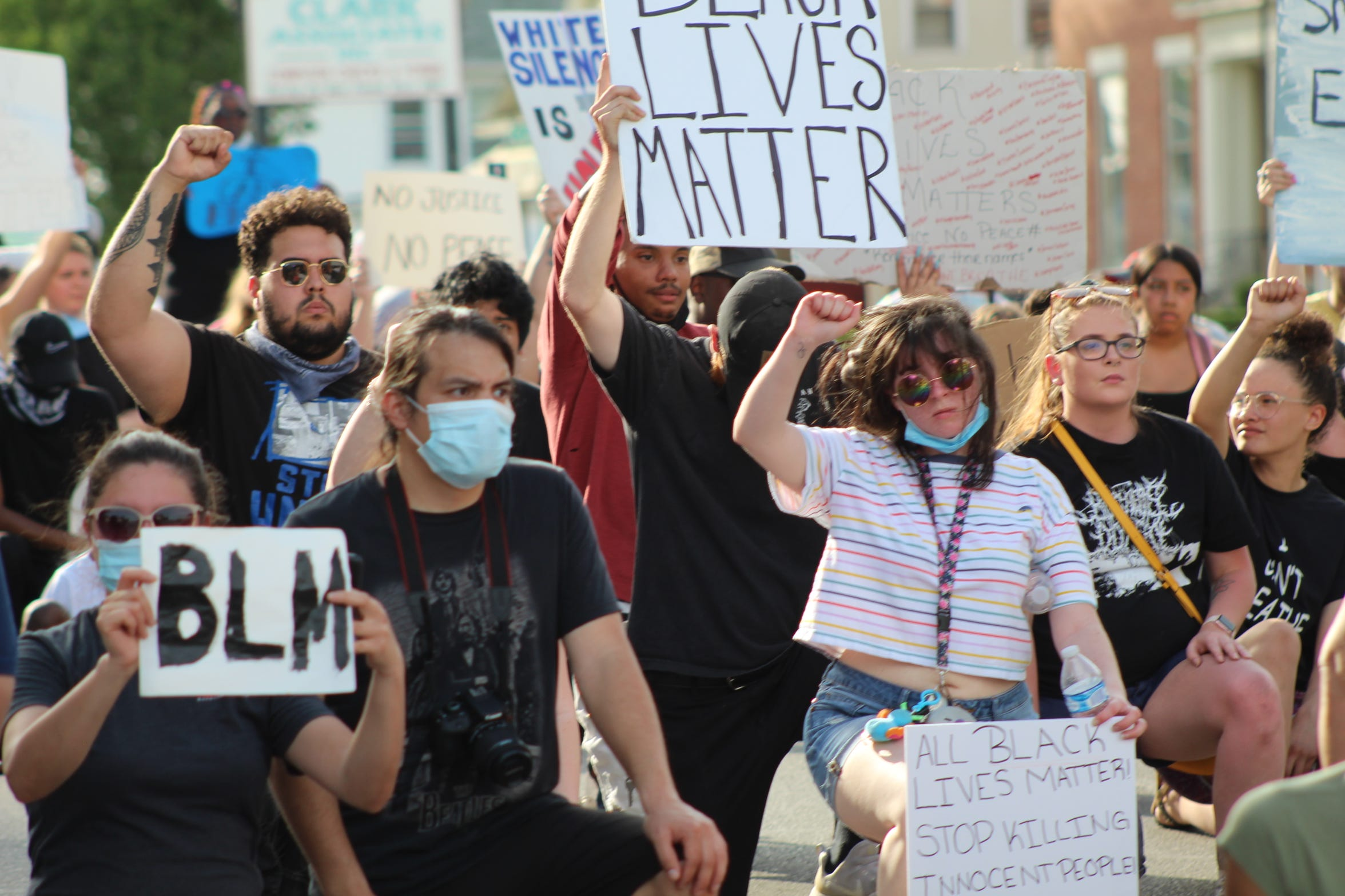 Protesters took a knee on West State Street to protest racism and police brutality Wednesday at the Anti-Racism Vigil: Stand for Justice for George Floyd and all victims of racist violence in Fremont.