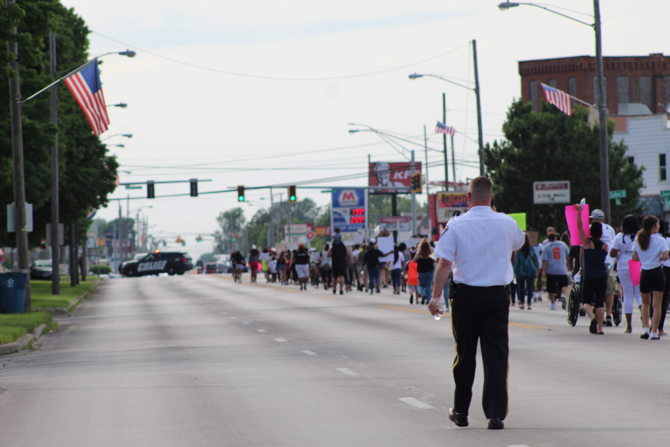 Fremont Police Chief Dean Bliss walks with hundreds of protesters on West State Street at the anti-racism vigil.