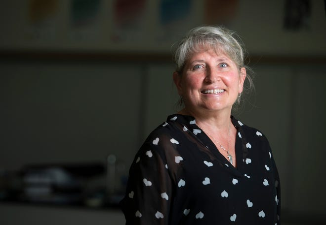 Poudre High School science teacher Kelly Suto, who is retiring after more than 34 years of teaching, stands in her classroom at Poudre High School in Fort Collins, Colo. on Friday, May 29, 2020.