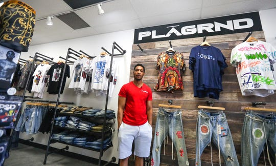 Synika Kirk,  owner of PLAGRNDr, stands in his urban fashion store. On Sunday, someone broke into the west-side store  while police were involved in a confrontation in downtown Green Bay after a peaceful protest became chaotic.