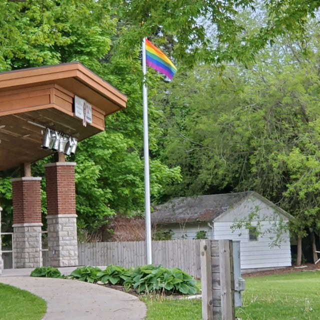 A Pride Flag soars in Martin Park in downtown Sturgeon Bay after the mayor formally proclaimed June as Open Door Pride Month, a nod at the local LGBTQ group.
