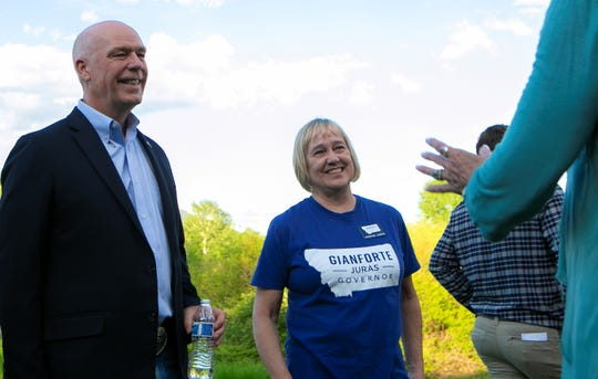 Greg Gianforte and his running mate, Kristen Juras, speak with friends, family and campaign workers during an election party in Gianforte's back yard Tuesday in Bozeman.