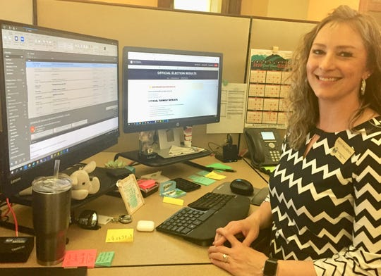 Missy McLarnon of the Montana Secretary of State's office checks emails Tuesday evening from county elections administrators.