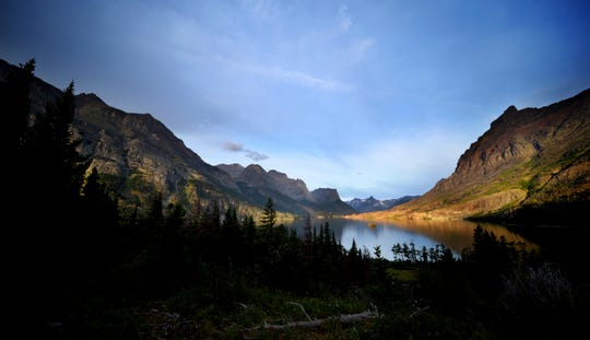 FILE - This Aug. 14, 2019, file photo shows a view of the iconic Wild Goose Island from Going-to-the-Sun Road on St. Mary Lake at sunrise in Glacier National Park. The park will start a limited reopening for visitors on Monday, June 8, 2020, with the opening of the west entrance at West Glacier. The east entrances to the park will remain closed because the neighboring Blackfeet Indian Reservation has coronavirus restrictions in place through June 30. (Brenda Ahearn//The Daily Inter Lake via AP, FIle)