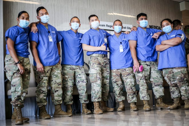 Combat medics from the Guam National Guard are recognized at a ceremony at Guam Regional Medical City on May 29. The medics, who have been at the hospital since April for COVID-19 support, assist nurses with daily operations in the GRMC emergency room.