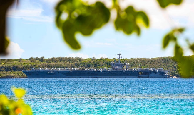 The U.S.S. Theodore Roosevelt, a U.S. Navy nuclear-powered aircraft carrier, is docked at the Naval Base Guam in Sumay after pulling into to port on Wednesday, June 3, 2020.