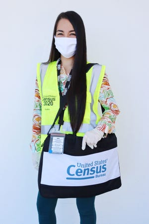 Census workers are identifiable by their bright yellow 2020 Census of Guam safety vest, a U.S. Census Bureau tote bag and two official government badges.