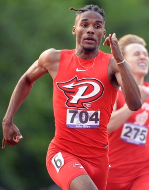 Pike's Jahn Riley wins the 400 meter dash during the boys IHSAA track and field state finals at Robert C. Haugh Track and Field complex in Bloomington, Ind. on Friday, May 31, 2019.