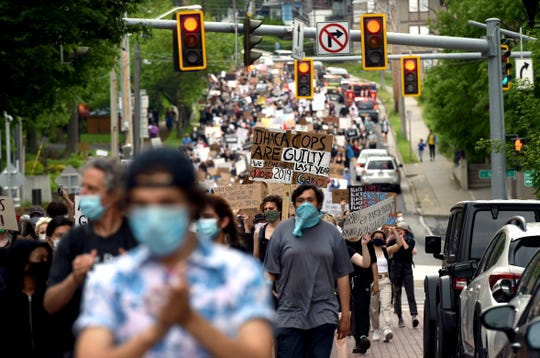 Hundreds of protesters marched from Cornell University to the Ithaca Police Department on Wednesday, June 3, 2020, in a peaceful protest against police brutality and oppression.