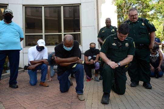 The community of Jackson joined together by taking a knee in front of Jackson City Hall, Tuesday, June 2, 2020. This peaceful protest is to stand against the police violence against African Americans.