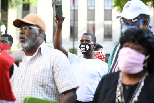 Tracy Boyd lives streams the peaceful protest in front of City Hall in Jackson, Tenn., Tuesday, June 2, 2020. The community of Jackson stand together by taking a knee in front of Jackson City Hall, Tuesday, June 2, 2020 with City Councilman Johnny Dodd and Mayor Conger. This peaceful protest is to stand against the police violence against African Americans.
