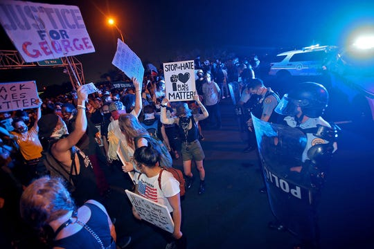 New Orleans Police and Louisiana State Police face hundreds of protesters blocking the elevated I-10 in both directions at the Orleans Avenue exit to protest the killing by police of George Floyd and others. Photographed on Tuesday, June 2, 2020. (Photo by Michael DeMocker)