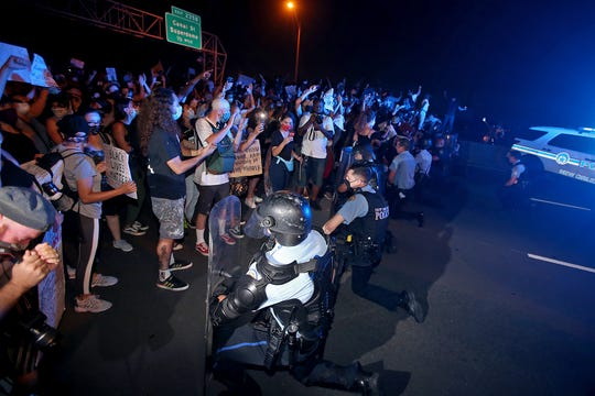 Members of the New Orleans Police Department and Louisiana State Police take a knee as hundreds of protesters block the elevated West Bank Expressway in both directions at the Orleans Avenue exit to protest the killing by police of George Floyd and others. Photographed on Tuesday, June 2, 2020. (Photo by Michael DeMocker)