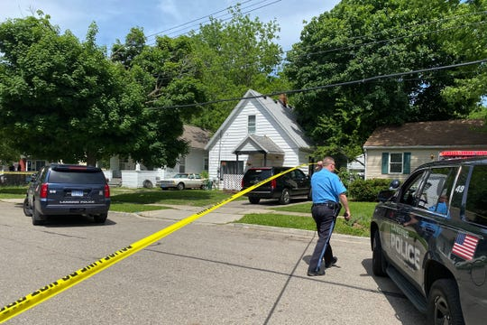 Lansing Police at the scene of a shooting in the 900 block of Johnson Street in Lansing.