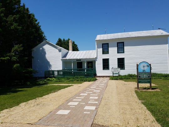 The front of the McAllister House Welcome Center at the Manitowoc County Historical Society, with a new brick walkway installed by Highway Landscapers Inc.