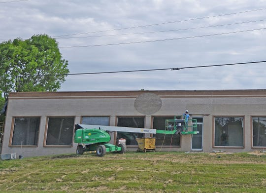 Work is being done inside and out to transform the former Jerry's Home Furnishings building into a school that will open in August.