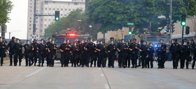 A couple of hundred protesters clash with Milwaukee police  attempting to disperse the crowd near 6th Street and McKinley Avenue on June 2. Police used rubber bullets and tear gas to disperse the crowd that was protesting the death of George Floyd at the hands of a Minneapolis police officer.