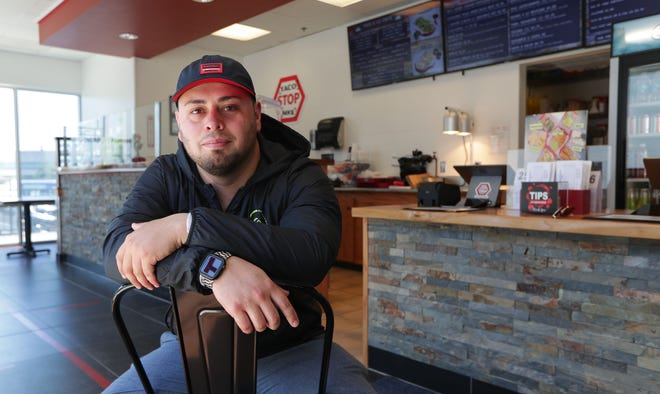 Taco Stop MKE co-owner AJ Agiss at the restaurant's newest location, 2121 S. Kinnickinnic Ave. in Bay View. He and his family had intended to open it in March; then the pandemic and stay-at-home orders hit.