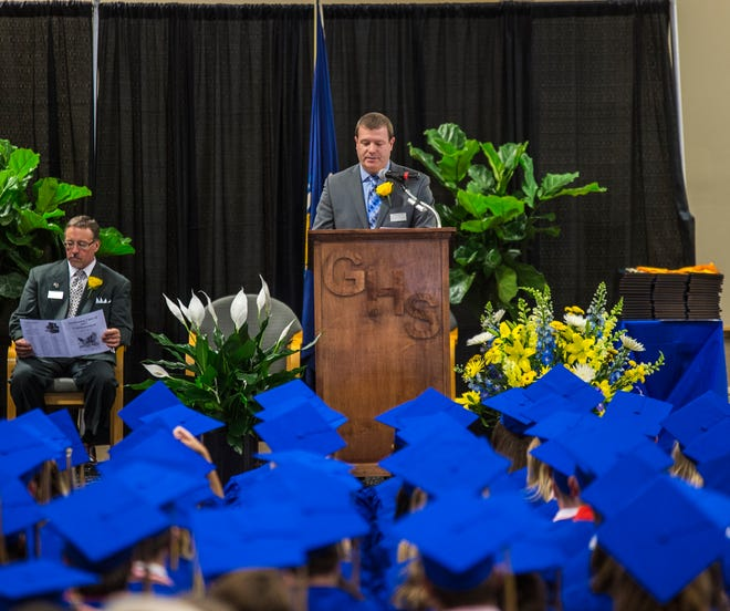 Germantown High School principal Joel R. Farren addresses seniors during Germantown's 2017 graduation ceremony. The school is planning a traditional, in-person ceremony this year, with public health measures in place, on July 10 at Datka Stadium.