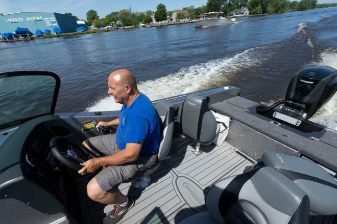 Spellman's Marina owner Tim Doberstein drives a Warrior V208 mated with a 300 G2 Evinrude engine June 3 on the Fox River in Oshkosh, Wis. BRP (Bombardier Recreational Products), the Canadian manufacturer of Evinrude outboard engines, announced it will no longer make Evinrudes, leaving dealerships in a tough spot and marking the end of an iconic Wisconsin brand.