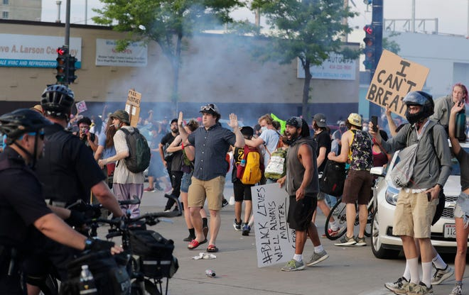 A couple of hundred protesters clash with Milwaukee police  attempting to disperse the crowd near the 6th Street and McKinley, Tuesday. Police used rubber bullets and tear gas to disperse the crowd that was protesting the death of Gorge Floyd at the hands of a Minneapolis police officer.