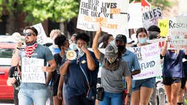 Activists, citizens gather on Dexter Ave. to rally for justice, equity, accountability