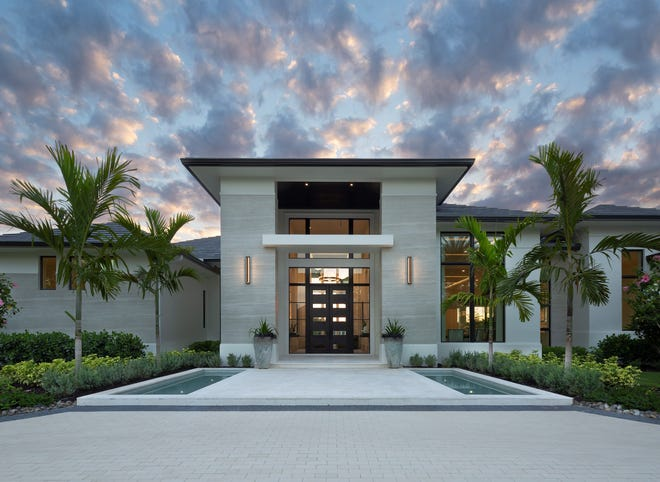 An exterior view of Diamond Custom Homes' Laurène model estate home, recently sold in Quail West Golf & Country Club.