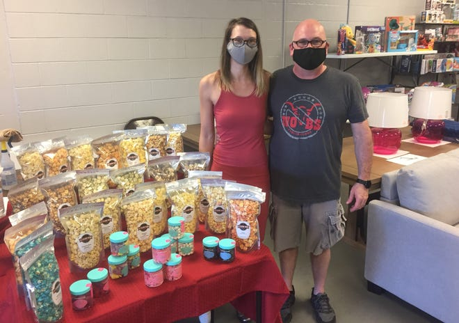 """NO BS Liquidators co-owners Shannon Prior and Brent Rudolph recently added """"Al's Delicious Popcorn,"""" another Columbus-based entrepreneurial effort, to their store's offerings."""