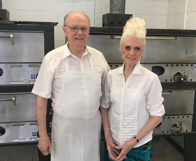 Bob and Sue Ann Campbell, owners of Louie's Pizza, celebrate the 60th anniversary of the restaurant on Saturday and will celebrate their 50th wedding anniversary in February.