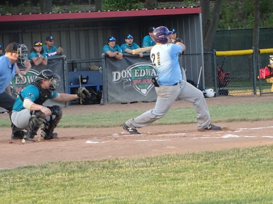 Utica graduate Garett Robberts hits an RBI single for the Ohio Marlins on Tuesday in the first inning of a 7-5 loss to the Ohio Bison at Don Edwards Park.