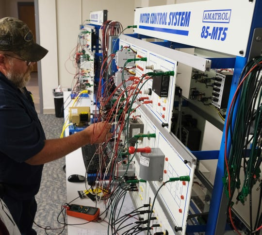 A C-TEC adult education student training on motor controls in the Multicraft Maintenance program.