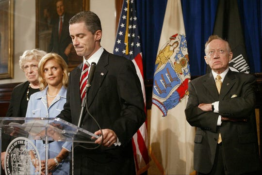 Gov James McGreevey announces his resignation after revealing that he is gay. Along side him are his mother Veronica, wife Dina and father Jack. August 12, 2004.