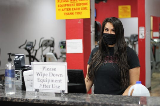 Veronica Martinez waits for patrons at the front desk of Stay Fit Fitness on Wednesday, June 3, 2020.
