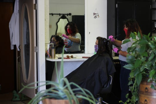 At Violeta's Beauty Shop, Arlene Hernandez dyes Amanda Nuñez's hair for the first time in months on Wednesday, June 3, 2020. Nuñez said she is grateful for the precautions the salon takes, as she works closely with people who are immunocompromised.