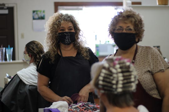 Vanessa Melendrez and Yolie Placencio are happy to be back working at Nessa's Hair and Nail Salon on Wednesday, June 3, 2020. They take the temperature of every patron before allowing them in.
