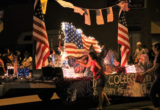 A San Juan College float is towed down West Main Street during the Electric Light Parade on July 4, 2019, in downtown Farmington. This year's parade will be held on the college campus with a drive-thru format.