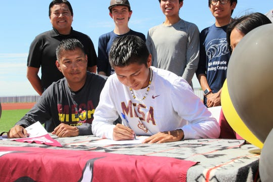 Piedra Vista's Triston Charles signs his national letter of intent on Wednesday, June 3, 2020, to continue his cross-country career at NCAA Division II Colorado Mesa University in Grand Junction, Colorado.