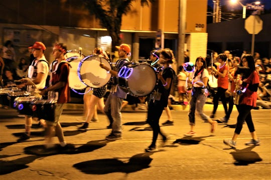 A march band takes part in the annual Electric Light Parade on July 4, 2019, in downtown Farmington.