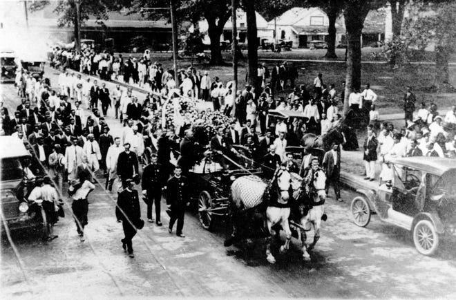 The funeral procession of Sheriff Marion Lewis Swords as it went down Landry Street in front of the St. Landry Parish Courthouse on Tuesday, July 18, 1916.