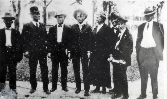 Hilaire Carriere, fourth from left in center of photo, as he arrived in Opelousas from the Lake Charles jail to stand trial for the murder of Sheriff Marion Lewis Swords in October of 1916. Second from left in the photo is Calcasieu Parish Sheriff Henry O. Reid, Sr.