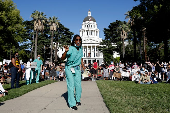 Protesters rally outside the California Capitol in May.