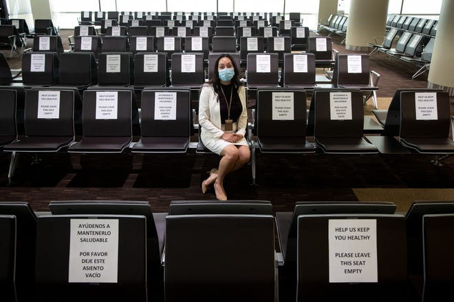A portrait of jury administrator Nicole Garcia in the jury assembly room on June 3, 2020, at Maricopa County Superior Court in Phoenix. Capacity of the jury assembly room has gone from 811 to 30 because of social distancing guidelines.