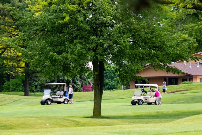 People golf at Port Huron Golf Course Wednesday, June 3, 2020, in Port Huron. Gov. Gretchen Whitmer announced this week that pro shops, bars and restaurants on golf courses would be allowed to reopen.