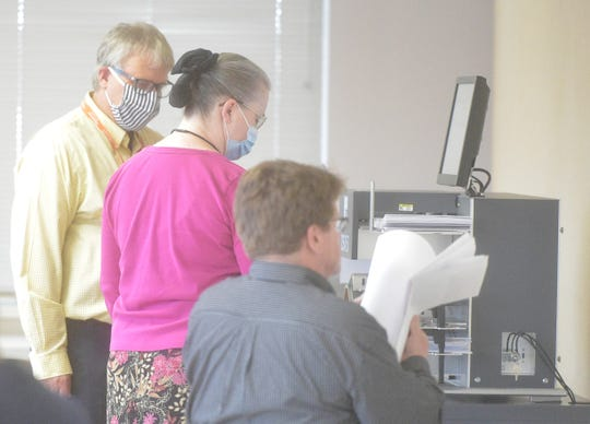 Jean Byers, Franklin County's director of elections, is assisted by IT staff as ballots are counted with the recently-purchased high-speed central scanner on Wednesday, June 3, 2020.