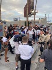 "Las Vegas Police speak with protesters before their march begins on Naples Drive just outside of the Thomas & Mack Center in Las Vegas. The two officers exchanged information with the protesters to ensure ""a safe protest."""