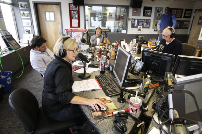 "A file photo of Kimberly Ray and Barry Beck while on the air for their ""Kimberly and Beck"" radio show. Both lost their jobs this past week at iHeartRadio over racist comments they made."