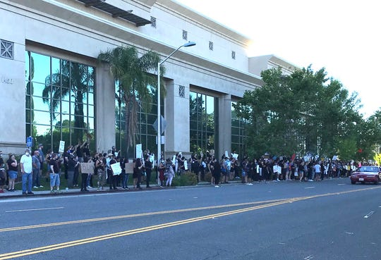 A crowd Tuesday evening, June 2, 2020 swells to several hundred chanting protesters, who remained peaceful outside the Shasta County Courthouse.
