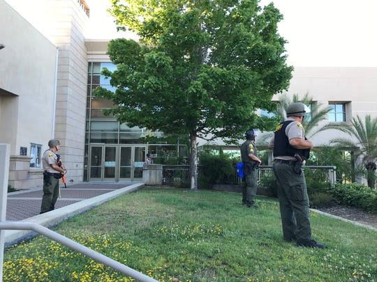 Shasta County sheriff's deputies stand outside the county administration building because of a march protesting police brutality in light of George Floyd's death in Minnesota.