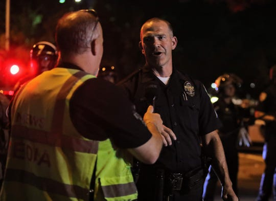Redding police Sgt. Mark Montgomery oversees a protest in downtown Redding on Tuesday, June 2, 2020, over George Floyd's death at the hands of Minneapolis police.