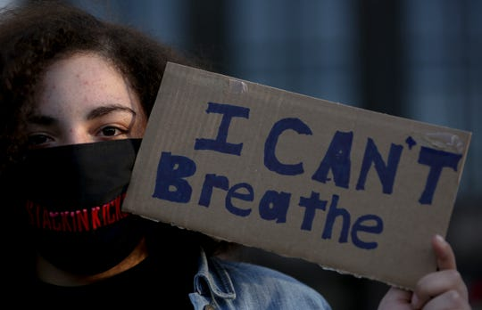 Aniya Kindred, 15, holds up a sign during a peaceful rally, celebrating black culture and remembering George Floyd and other victims of police violence, in Salem, Oregon on Tuesday, June 2, 2020.
